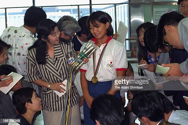 Barcelona Olympic Women's 200m Breaststroke Gold Medalist Kyoko Iwasaki is surrounded by media reporters upon arrival at New Tokyo International...
