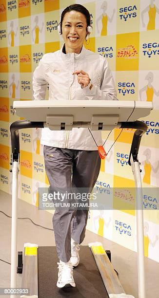 Barcelona Olympic women's marathon silver medalist and Atlanta Olympic bronze medalist Yuko Arimori demonstrates Sega Toys' 'Karada Trainer ' during...