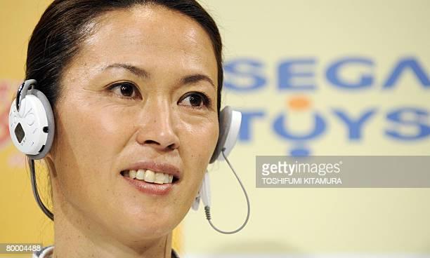 Barcelona Olympic women's marathon silver medalist and Atlanta Olympic bronze medalist Yuko Arimori shows off Sega Toys' 'Karada Trainer ' during its...