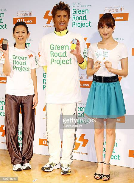 Barcelona Olympic women's marathon silver medalist Yuko Arimori model Yuri Ebihara and ex professional baseball player Tsuyoshi Shinjo pose during...