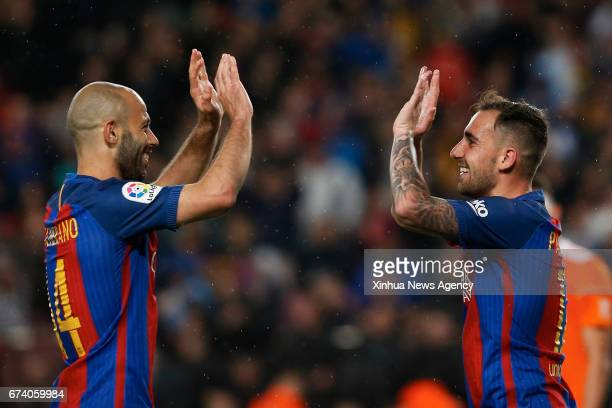 Barcelona Paco Alcacer celebrates after scoring with Barcelona's Javier Mascherano during the Spanish first division soccer match FC Barcelona...