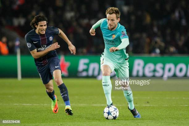 FC Barcelona player Ivan Rakitic vies with PSG Edinson Cavani during the UEFA Champions League round of 16 first leg football match between Paris...