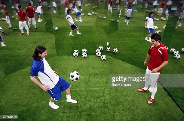 Barcelona player Lionel Messi juggles the ball with Valencia player David Villa during the adidas F50 TUNiT football boot launch on February 11 2008...