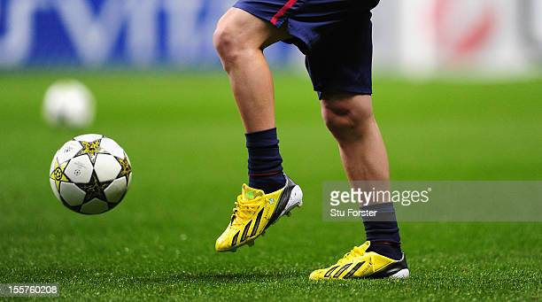 Barcelona player Lionel Messi wearing a new pair of Boots before the UEFA Champions League Group G match between Celtic and Barcelona at Celtic Park...