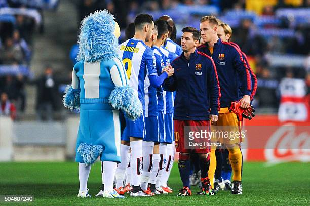 Barcelona players and RCD Espanyol players shake hands prior to the Copa del Rey Round of 16 second leg match between RCD Espanyol and FC Barcelona...