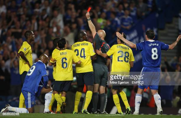 Barcelona players appeal as Barcelona's Eric Abidal is shown a red card by referee Tom Ovrebo after a foul on Chelsea's Nicolas Anelka