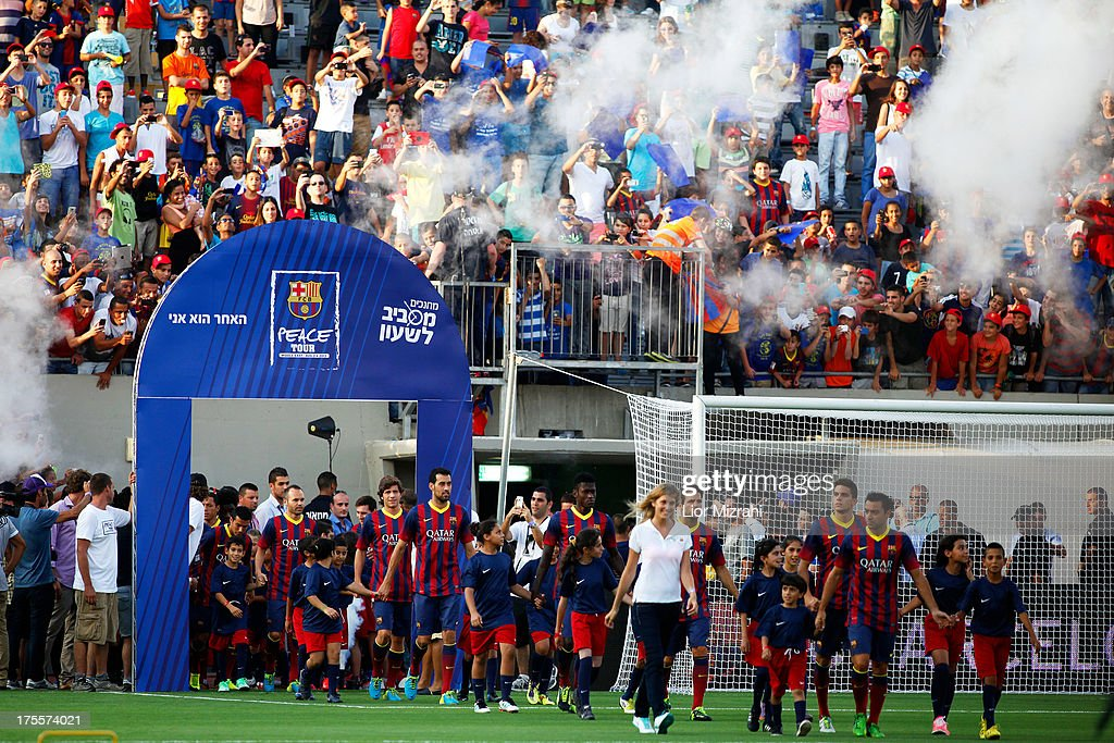 FC Barcelona players arrive to take part in a training session on August 4, 2013 in Tel Aviv, Israel. Members of the FC Barcelona squad have travelled to the Middle East to visit Israel and the West Bank as part of a two-day 'peace tour'.