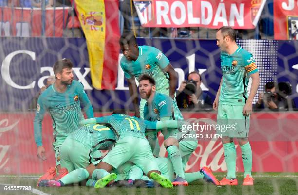 Barcelona players celebrate a goal during the Spanish league football match Club Atletico de Madrid vs FC Barcelona at the Vicente Calderon stadium...