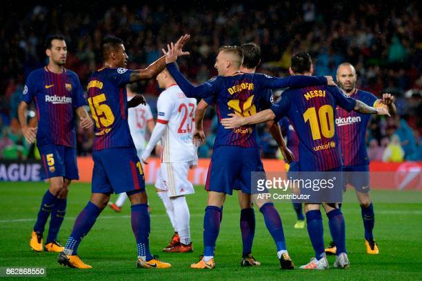 Barcelona players celebrate a goal during the UEFA Champions League group D football match FC Barcelona vs Olympiacos FC at the Camp Nou stadium in...