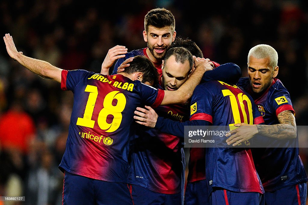 FC Barcelona players celebrate after David Villa of FC Barcelona scored the opening goal during the La Liga match between FC Barcelona and Rayo Vallecano at Camp Nou on March 17, 2013 in Barcelona, Spain.
