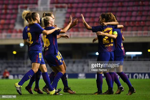 Barcelona players celebrate after Lieke Martens of FC Barcelona scored his team's first goal during the UEFA Womens Champions League round of 32...