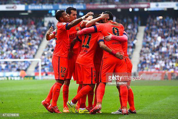 Barcelona players celebrate after Lionel Messi of FC Barcelona scored his team's second goal during the La Liga match between RCD Espanyol and FC...
