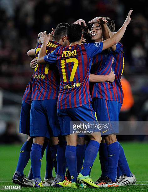 Barcelona players celebrate after Sergio Roberto of FC Barcelona scored the opening goal during the UEFA Champions League group H match between FC...
