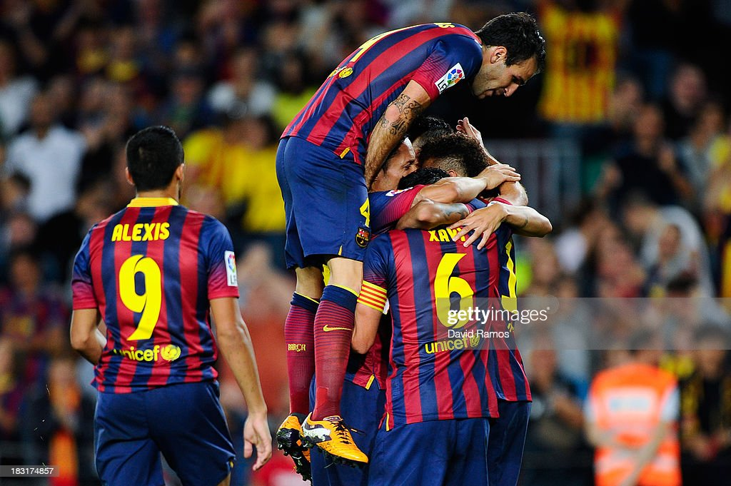 FC Barcelona players celebrate after Xavi Hernandez of FC Barcelona scored his team's second goalduring the La Liga match between FC Barcelona and Real Valladolid CF at Camp Nou on October 5, 2013 in Barcelona, Spain.