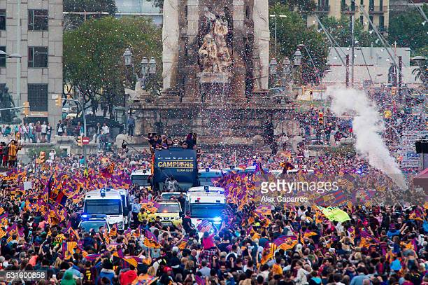 Barcelona players celebrate on an open top bus during their victory parade after winning the Spanish La Liga on May 15 2016 in Barcelona Spain
