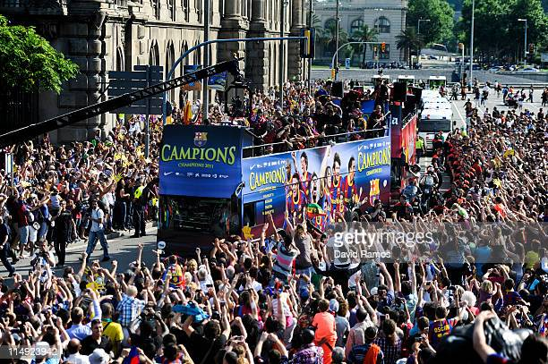 Barcelona players celebrate on board an open top bus after winning the UEFA Champions League Final against Manchester United on May 29 2011 in...