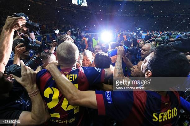 Barcelona players celebrate the win among photographers during the UEFA Champions League Final between Juventus and FC Barcelona at Olympiastadion on...
