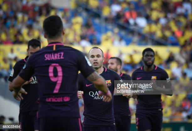 Barcelona players celebrate their second goal during the Spanish league football match UD Las Palmas vs FC Barcelona at the Gran Canaria stadium in...