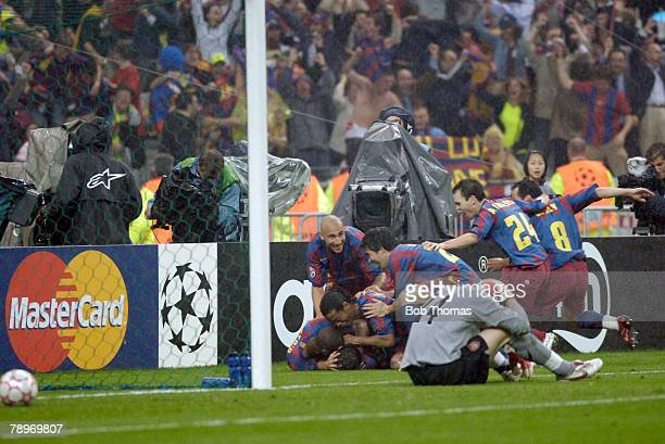 Sport Football UEFA Champions League Final Paris 17th May 2006 Barcelona 2 v Arsenal 1 Barcelona players celebrate their second goal with a dejected...