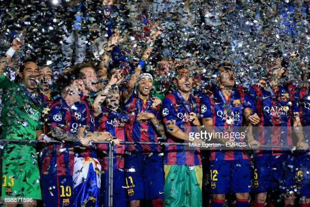 Barcelona players celebrate victory as confetti rains down on them