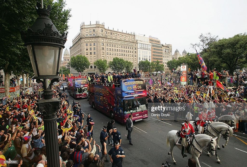 Barcelona players celebrate winning the Primera Liga on an openroof bus on May 7 2006 in Plaza Catalunya in Barcelona Spain