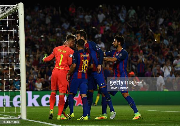 Barcelona players celebrate with MarcAndre ter Stegen of Barcelona after he saves a penalty from Moussa Dembele of Celtic during the UEFA Champions...