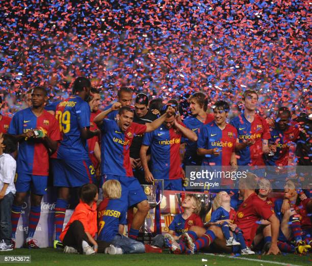 Barcelona players celebrate with the La Liga trophy after the La Liga match between Barcelona and Osasuna at the Nou Camp stadium on May 23 2009 in...