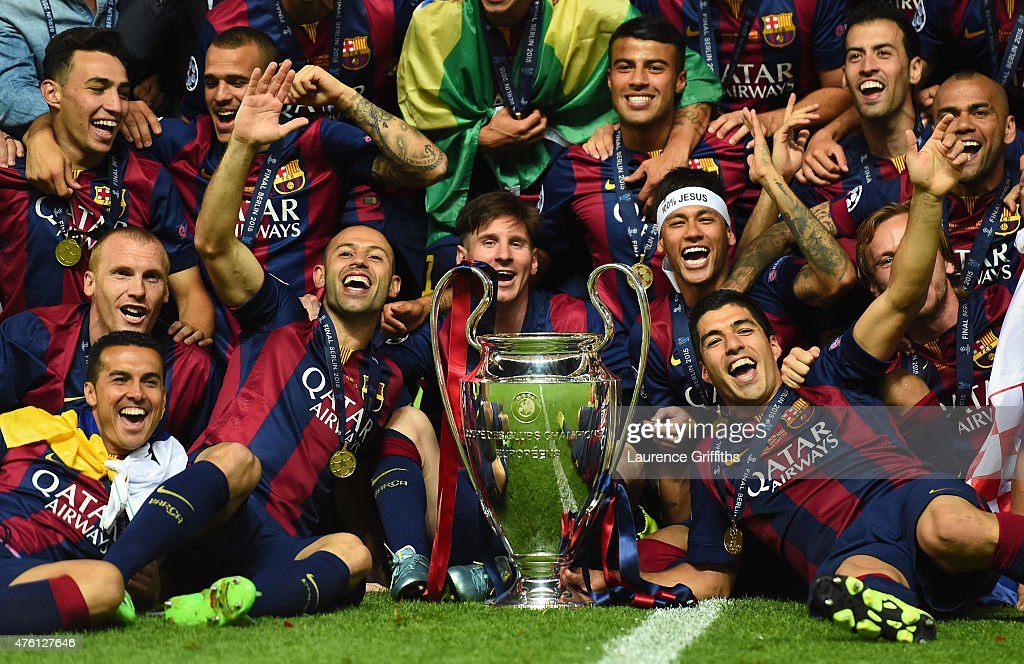Barcelona players including <a gi-track='captionPersonalityLinkClicked' href=/galleries/search?phrase=Javier+Mascherano&family=editorial&specificpeople=490876 ng-click='$event.stopPropagation()'>Javier Mascherano</a>, <a gi-track='captionPersonalityLinkClicked' href=/galleries/search?phrase=Lionel+Messi&family=editorial&specificpeople=453305 ng-click='$event.stopPropagation()'>Lionel Messi</a>, Neymar and Luis Suarez celebrate victory with the trophy after the UEFA Champions League Final between Juventus and FC Barcelona at Olympiastadion on June 6, 2015 in Berlin, Germany.