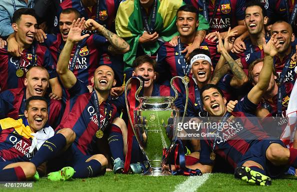Barcelona players including Javier Mascherano Lionel Messi Neymar and Luis Suarez celebrate victory with the trophy after the UEFA Champions League...