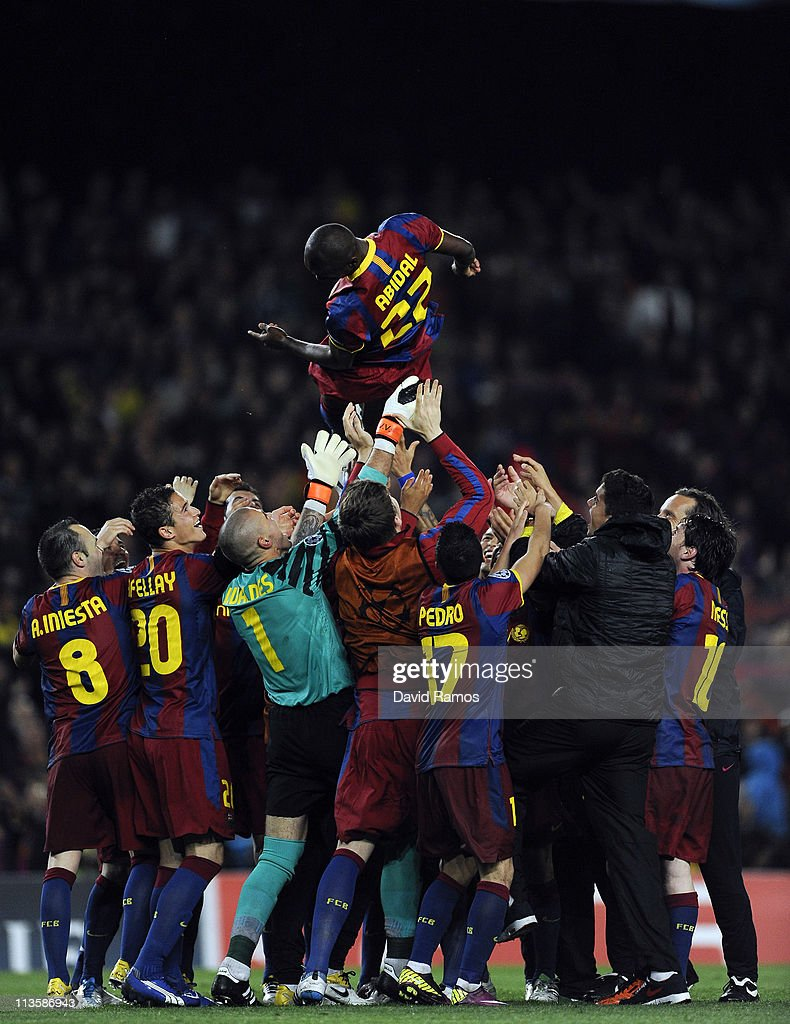 FC Barcelona players lift his teammate <a gi-track='captionPersonalityLinkClicked' href=/galleries/search?phrase=Eric+Abidal&family=editorial&specificpeople=469702 ng-click='$event.stopPropagation()'>Eric Abidal</a> after defeating real Madrid at the end of the UEFA Champions League Semi Final second leg match between Barcelona and Real Madrid at the Camp Nou on May 3, 2011 in Barcelona, Spain.