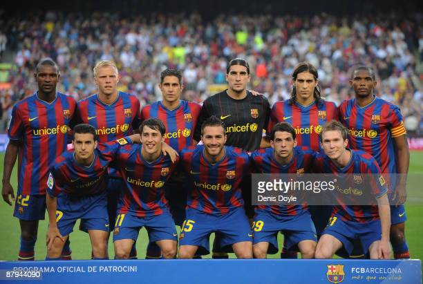 Barcelona players lineup with the new team outfit for the 2010 season before the La Liga match between Barcelona and Osasuna at the Nou Camp Stadium...