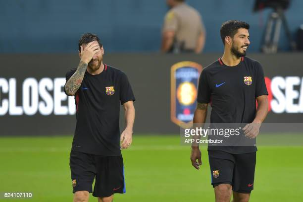 Barcelona players Lionel Messi and Luis Suarez take part in a training session at Hard Rock Stadium in Miami Florida on July 28 one day before their...