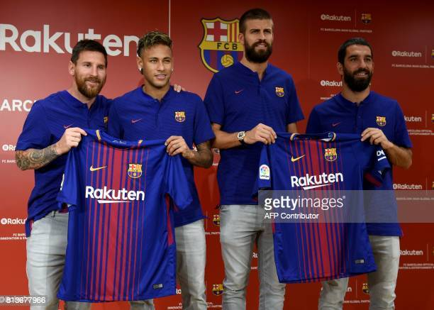 FC Barcelona players Lionel Messi Neymar Gerard Pique and Arda Turan show off their new jersey with the Rakuten sponsorship logo for the first time...