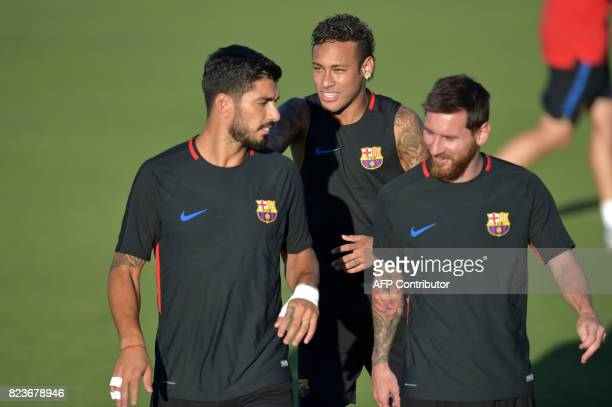 TOPSHOT Barcelona players Luis Suarez Neymar and Lionel Messi take part in a training session at Barry University in Miami Florida on July 27 two...