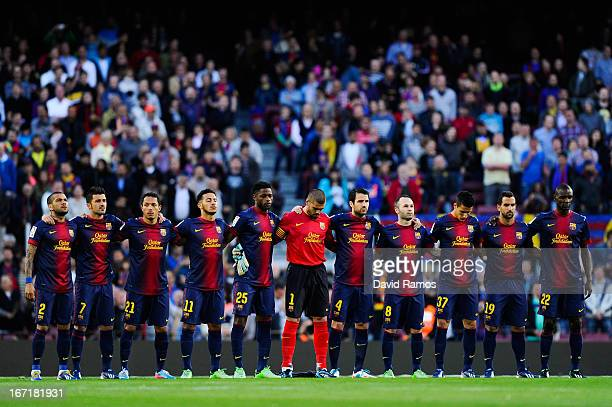 Barcelona players observe a minute silence in memory of the victims of the Boston's Marathon terrorist attack during the La Liga match between FC...