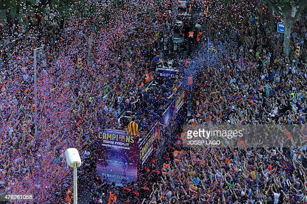 FC Barcelona players parade on a bus through the streets of Barcelona as they celebrate their victory over Juventus one day after the UEFA Champions...