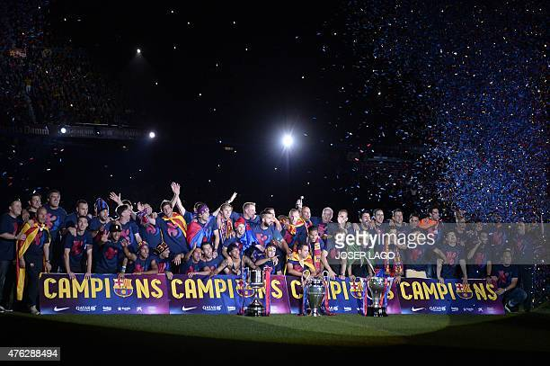 Barcelona players pose as they take part in the celebrations held for their victory over Juventus one day after the UEFA Champions League final...
