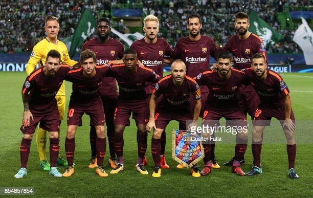 Barcelona players pose for a team photo before the start of the UEFA Champions League match between Sporting Clube de Portugal and FC Barcelona at...