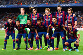 Barcelona players pose for a team picture during the UEFA Champions League Group F match between FC Barcelona and APOEL FC at the Camp Nou Stadium on...