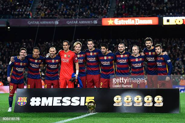 Barcelona players pose with Lionel Messi and the FIFA Ballon d'Or trophy prior to the La Liga match between FC Barcelona and Athletic Club de Bilbao...
