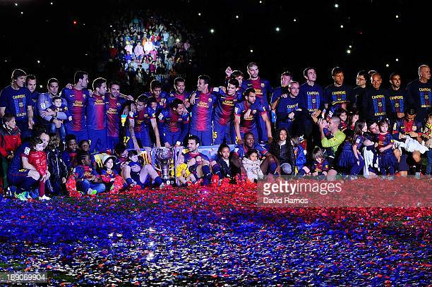 Barcelona players pose with the trophy during the celebration after winning the Spanish League after the La Liga match between FC Barcelona and Real...