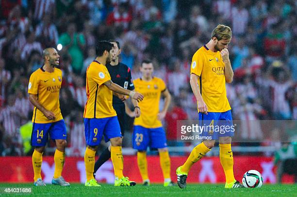 Barcelona players react dejected during the Spanish Super Cup first leg match between FC Barcelona and Athletic Club at San Mames Stadium on August...
