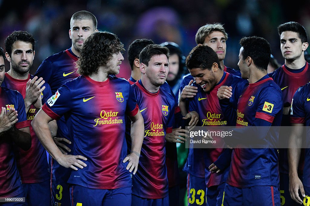 FC Barcelona players stands on the picth during the celebration after winning the Spanish League after the La Liga match between FC Barcelona and Real Valladolid CF at Camp Nou on May 19, 2013 in Barcelona, Spain.