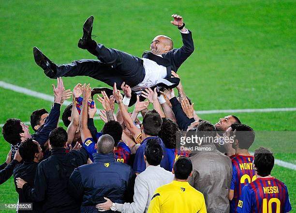 Barcelona players throw Josep Guardiola their head coach into the air at the end of the La Liga match between FC Barcelona and RCD Espanyol at Camp...