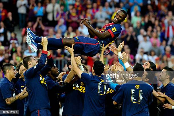 Barcelona players throw their teammate Eric Abidal into the air after he played his last match with FC Barcelona at the end of the La Liga match...