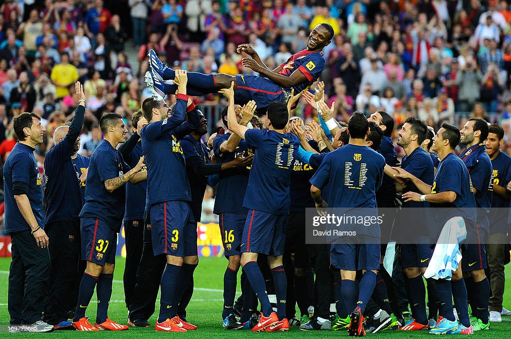 FC Barcelona players throw their team-mate <a gi-track='captionPersonalityLinkClicked' href=/galleries/search?phrase=Eric+Abidal&family=editorial&specificpeople=469702 ng-click='$event.stopPropagation()'>Eric Abidal</a> into the air after he played his last match with FC Barcelona at the end of the La Liga match between FC Barcelona and Malaga CF at Camp Nou on June 1, 2013 in Barcelona, Spain.