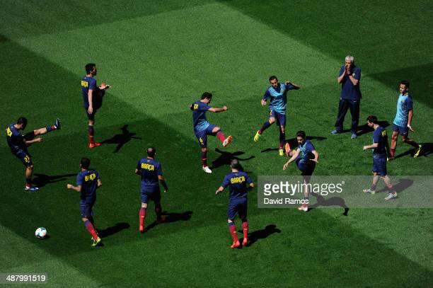 Barcelona players warm up prior to the La Liga match between FC Barcelona and Getafe CF at Nou Camp on May 3 2014 in Barcelona Spain
