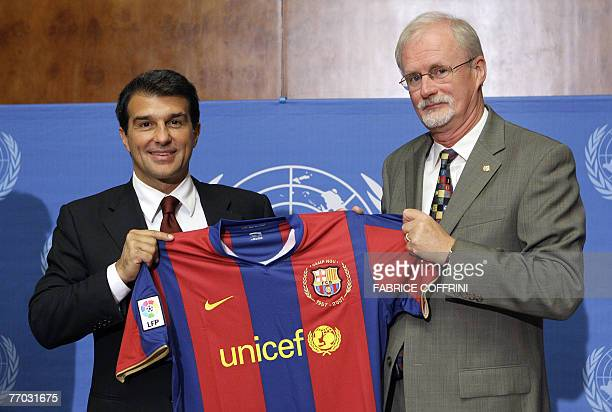 FC Barcelona President Joan Laporta holds the jersey of the Spanish football club with UNICEF Europe Regional Director Philip OBrien during a press...