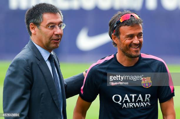 Barcelona President Josep Maria Bartomeu and Head coach Luis Enrique look on during a FC Barcelona training session at Ciutat Esportiva de Sant Joan...