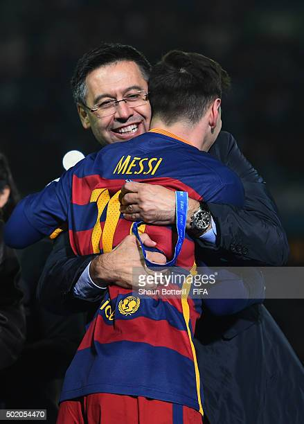 Barcelona President Josep Maria Bartomeu is hugged by Lionel Messi of Barcelona following their team's 30 victory during the FIFA Club World Cup...